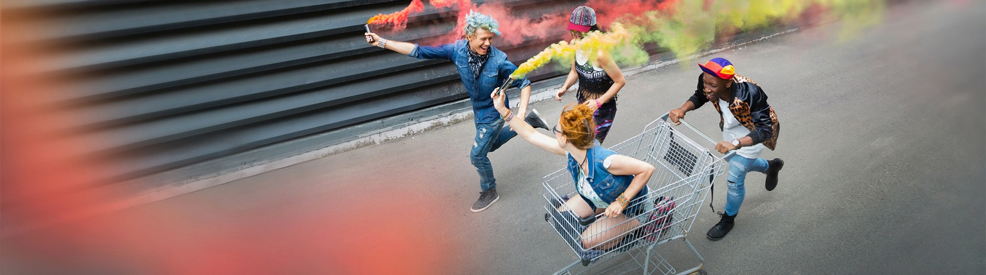 teenagers with colorful smoke bombs